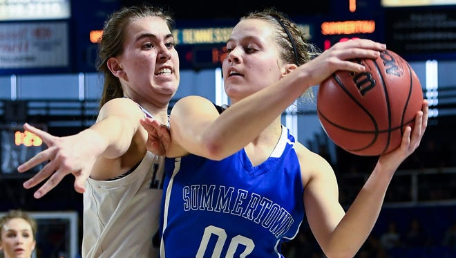 Summertown center Josie Franks (00) keeps the ball from Unaka's Erika Potter (44) during the second half of their semifinal game in the TSSAA Division I Class A Girls BlueCross Basketball Championships at Murphy Center Friday, March 9, 2018 in Murfreesboro, Tenn.
