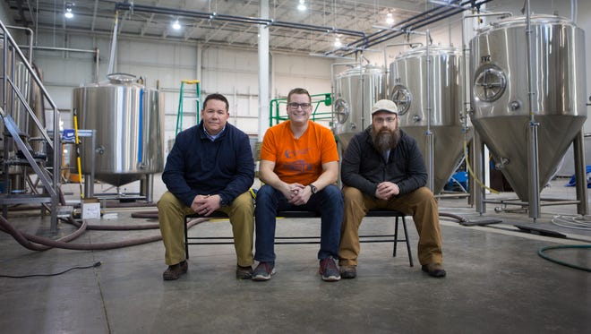 Joe Stickel, left, Patrick Jones, center, T.J. McGrath of Midnight Oil Brewing Company, a new brewery opening in Glasgow next weekend.