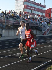 Edward Esbeck, front, competes in the 1,600 meters