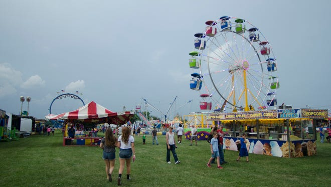 Visitors to the Wayne County 4-H Fair enjoyed rides and other entertainment Monday, June 20, 2016.