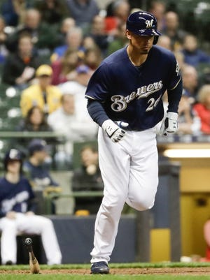 Brewers catcher Jacob Nottingham, who was making his major-league debut on Monday night, draws walks in both his plate appearances against the Reds. He also scored a run during the Brewers' four-run seventh.