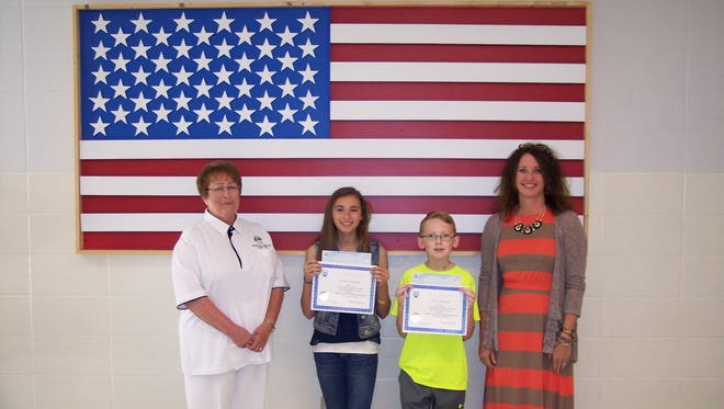 """Winners of the 2015~2016 Arkansas State Elks Americanism Essay Contest were recently honored during an awards assembly at Pinkston Middle School.  Sixth-grade winners were Sarah Vacco — first place certificate plus a $200 check and Ben Partney — second place certificate plus a $150 check. Their essays were chosen from more than 280 essays locally and then competed state wide and now go on to compete for national honors. Each year Elks lodges across the nation reach out to students to submit essays on Americanism this year's theme was """"What I Can Do to Promote Americanism and Love of Country."""" Shown are Cathy Schweer, Mountain Home Elks Lodge president, from left, Vacco, Partney and Vonya Schaufler, sixth grade social studies teacher and Elks Americanism chairman."""