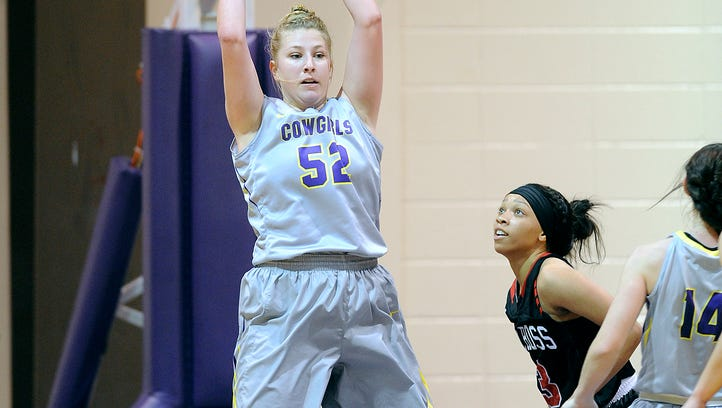 Hardin-Simmons' Heidi Schroeder (52) pulls down a rebound during the second quarter of the Cowgirls' 80-75 loss on Saturday, Jan. 14, 2017, at HSU's Mabee Complex.