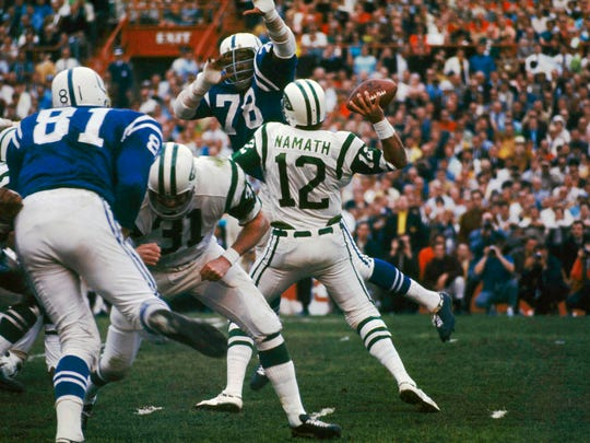 New York Jets quarterback Joe Namath passing during