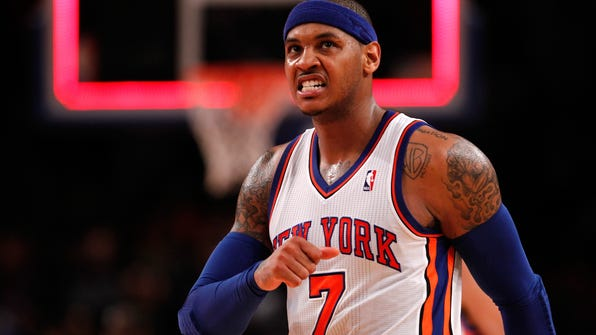 FILE - JULY 13, 2014: It was reported that Carmelo Anthony has reached a deal to remain with the New York Knicks July 13, 2014. NEW YORK, NY - MAY 06:  Carmelo Anthony #7 of the New York Knicks reacts in the second half against the Miami Heat in Game Four of the Eastern Conference Quarterfinals in the 2012 NBA Playoffs on May 6, 2012 at Madison Square Garden in New York City. NOTE TO USER: User expressly acknowledges and agrees that, by downloading and or using this photograph, User is consenting to the terms and conditions of the Getty Images License Agreement  (Photo by Jeff Zelevansky/Getty Images)