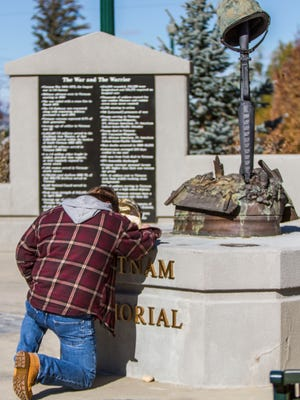A former service man takes a moment of silence at Cedar City's Veterans Park, Nov. 11, 2015.