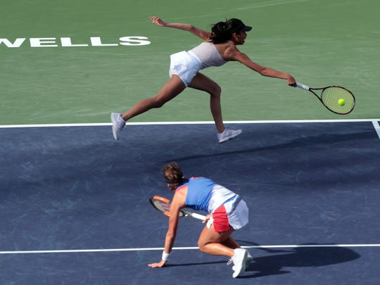 Su-Wei Hsieh of Taiwan dives for the ball as her doubles partner Barbora Strycove of the Czech Republic moves out of the way during their BNP Paribas Open finals match against the Russian pair of Ekaterina Makarova and Elena Vesnina on Saturday, March 17, 2018 in Indian Wells.