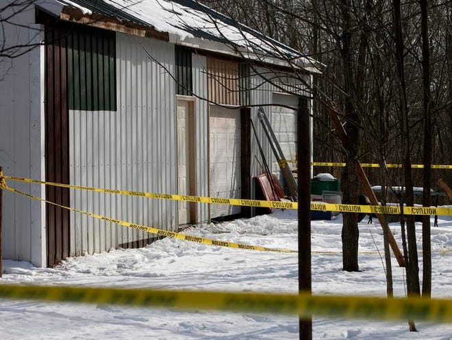 Police investigate an alleged murder at 503 E. Race St. in Eaton Sunday.  According to investigators, a man was shot to death with a small caliber handgun Saturday morning by another man who fled the scene.  The body of the victim and a firearm was found in a pole barn on the property.