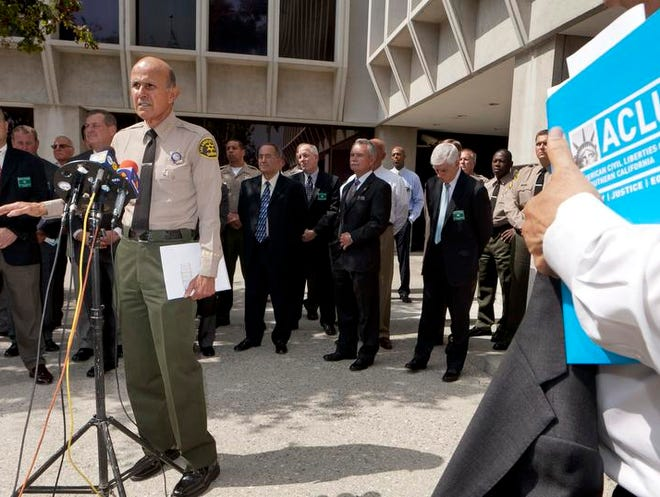 In this Sept. 28, 2011 file photo, Los Angeles County Sheriff Lee Baca takes questions about alleged inmate abuse in the nation's largest jail system.