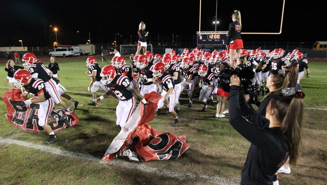 The Brophy Broncos take the field before a football game against Pinnacle at Phoenix College in Phoenix, Arizona on November 6, 2015.