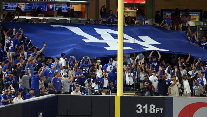 Dodgers fans unfurl a massive banner in the left field corner at Yankee Stadium.
