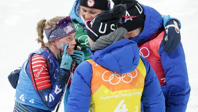 Jessica Diggins (USA) reacts with teammates during the women's 4x5km cross-country skiing relay.