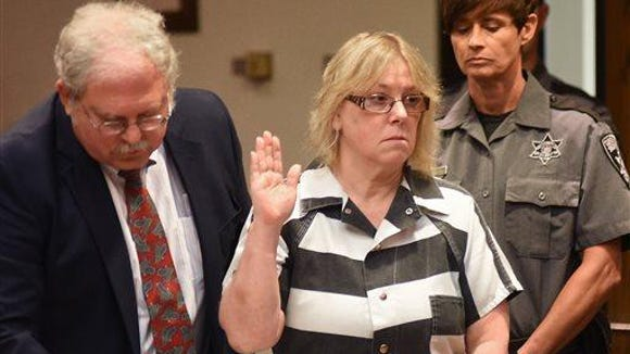 Joyce Mitchell raises her hand during a court appearance on July 28, 2015, in Plattsburgh.