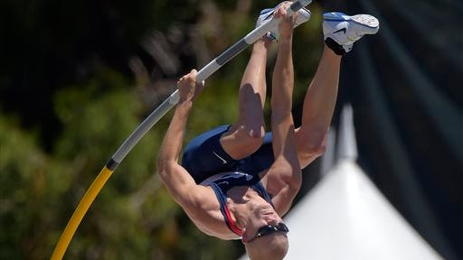 Sam Kendricks goes up on his way to clearing 18 feet, 10 and 1/4 inches in the men's pole vault final at the U.S. outdoor track and field championships, Sunday, June 29, 2014, in Sacramento, Calif. Kendricks won the event with that vault. (AP Photo/Mark J. Terrill)
