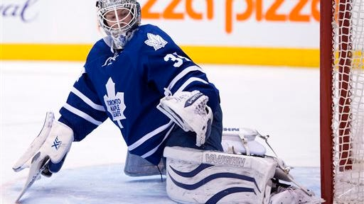 Toronto Maple Leafs goaltender James Reimer makes a save during third period of an NHL hockey game in Toronto, Monday, Jan. 19, 2015. (AP Photo/The Canadian Press, Frank Gunn)