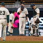 Michigan State pitcher Anthony Misiewicz (18) awaits his manager Jake Boss (23) to pull him from the game against Illinois as catcher Chad Roskelly, right, stands by in the third inning of a third-round NCAA Big Ten tournament college baseball game Friday, May 22, 2015, in Minneapolis.