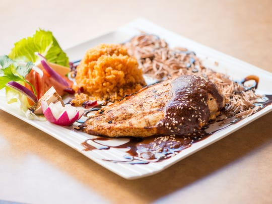 Some vendors at Fantasies in Chocolate are doing savory dishes to balance all the surrounding sweetness. MariChuy's Mexican Kitchen will serve chicken mole using chocolate from local Kimmie Candy Company instead of traditional Mexican chocolate.