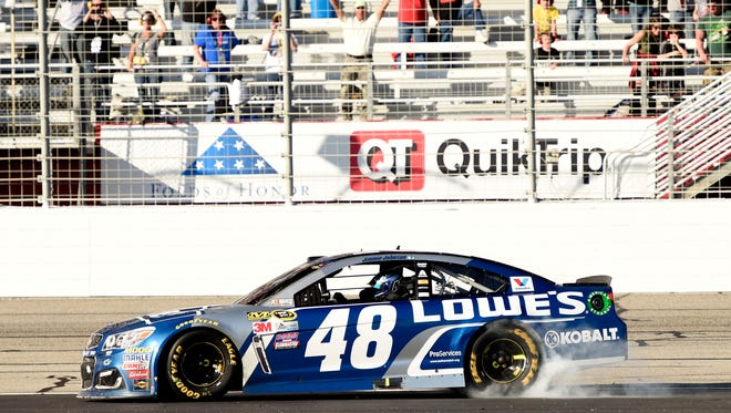 Jimmie Johnson celebrates with a burnout after winning the Folds of Honor QuikTrip 500 at Atlanta Motor Speedway.