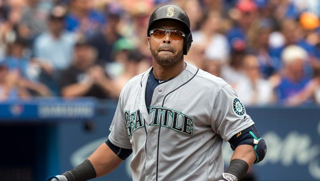 Seattle Mariners' Nelson Cruz walks back to the dugout after striking out during the fourth inning against the Blue Jays in a baseball game in Toronto on Sunday July 24, 2016. The Blue Jays won 2-0.