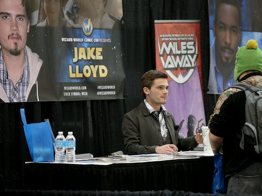 Jake Lloyd, who played the young Anakin Skywalker in the 1999 film Star Wars Episode I: The Phantom Menace, greets fans at the Wizard World Com Con. Wizard World Comic Con Indianapolis kicked off its inaugural stop Friday, February 13, 2015, afternoon at the Indiana Convention Center.