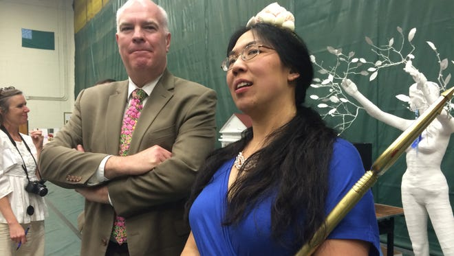 UVM classics professor Angeline Chiu (attired as Amphitrite, wife of Poseidon) and Sen. Joe Benning, R-Caledonia/Orange converse Friday at the 39th Latin Day. Benning's bill to adopt a Latin motto for the state was signed into law at the festivities by Gov. Peter Shumlin. In the background: a sculpture by Harwood High School Latin students of the mythical water nymph, Daphne, as she is transformed into a laurel tree.
