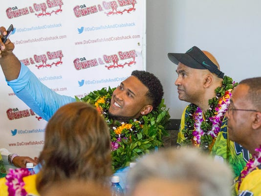 DeForest Buckner took a selfie with his father, George, at his NFL draft party held in Kapolei, Hawaii, Thursday, April 28, 2016.  The former Oregon star  was taken by the San Francisco 49ers as their top selection in the first round of the NFL draft Thursday. (Cindy Ellen Russell/The Star-Advertiser via AP)