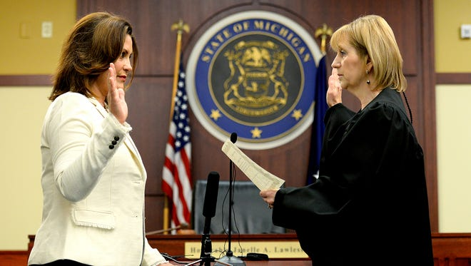 Former State Sen. Gretchen Whitmer is sworn in as Ingham County Prosecuting Attorney Tuesday, June 21, 2016 by Ingham County Circuit Court Chief Judge Janelle Lawless at the Veterans Memorial Courthouse in Lansing. Whither is serving a six-month term that began July 2. She replaced Stuart Dunnings III, who was arrested in March.
