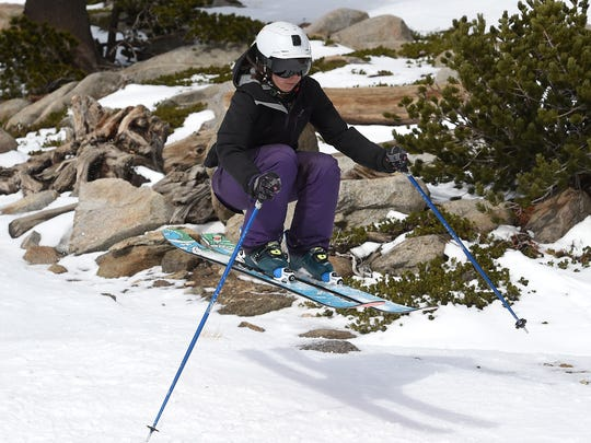 Jenn Sheridan catches some air using a pair of Coalition Snow skis up at Mt. Rose Ski Tahoe on Dec. 8, 2015.