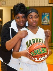 MOMENT OF THE WEEK: Mardela guard Demyra Selby celebrates her 2000th career point with mom Nikki Bozman against Wicomico on Thursday evening at Mardela High.