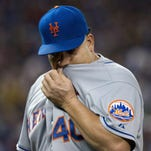 New York Mets starting pitcher Bartolo Colon is pulled during the fifth inning Thursday against the Blue Jays in Toronto.