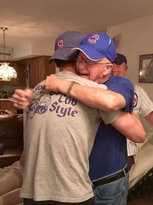 "Erwin ""Erv"" Schreiber hugged his grandson Paul Schreiber after the Cubs won the World Series."