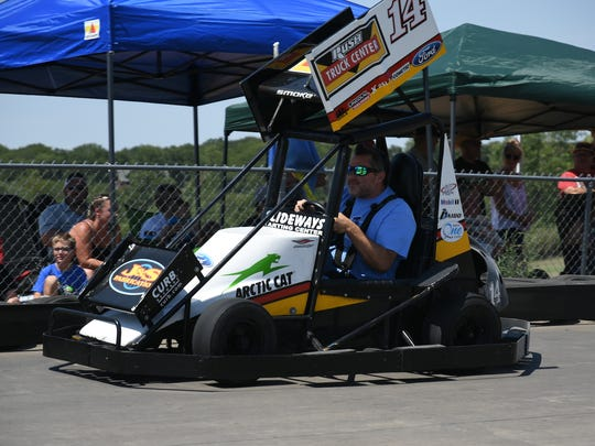 Tony Stewart drives against fans who paid $600 a pop to race against him and NASCAR stars Kyle Larson and Ricky Stenhouse Jr. at Slideways Karting Center in Knoxville on Wednesday.