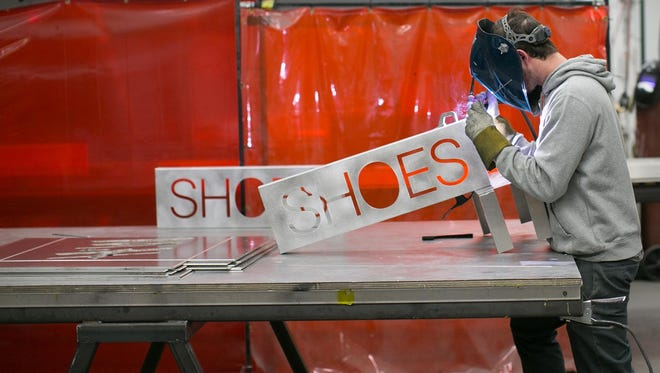 Joe Keenan of Rochester welds a sign at ID Signsystems in Rochester on Wednesday, February 10, 2016.