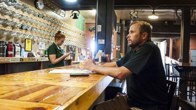 Wade Tingen enjoys a beer in Quarry Brewing on June 8.