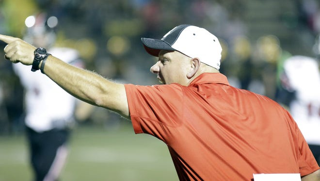 Oak Hills head coach Dan Scholz .