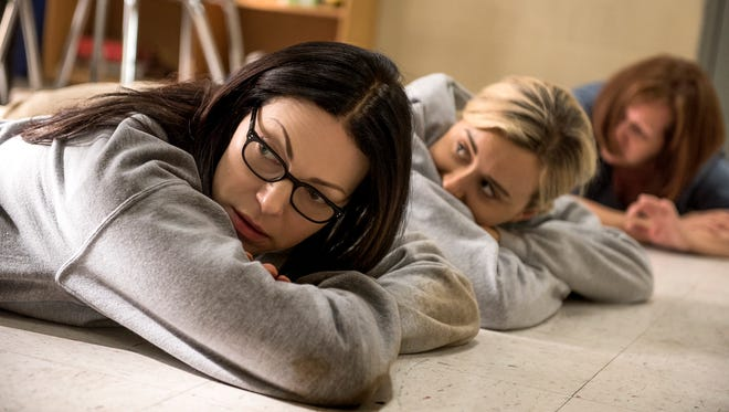 """Laura Prepon (left) and Taylor Schilling (center) star in Season 5 of """"Orange Is the New Black."""""""