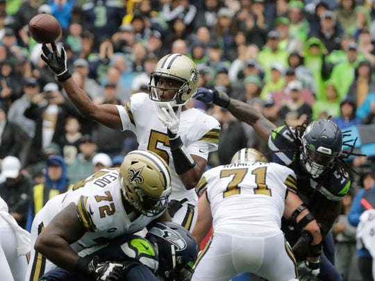 FILE- In this Sunday, Sept. 22, 2019, file photo, New Orleans Saints quarterback Teddy Bridgewater passes as Saints' Terron Armstead (72) and Ryan Ramczyk (71) hold off Seattle Seahawks outside linebacker Jadeveon Clowney, upper right, during the first half of an NFL football game in Seattle. Sundays game against the Dallas Cowboys could be an important game in the overall NFC playoff scheme, particularly if Bridgewater remains effective at quarterback until Brees is healthy. (AP Photo/Ted S. Warren, File)
