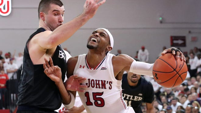 Butler will be looking for more scoring by senior Andrew Chrabasz against Providence on Sunday. Chrabasz, at left blocking St. John's Red Storm guard Marcus LoVett during their game Thursday, scored just four points.