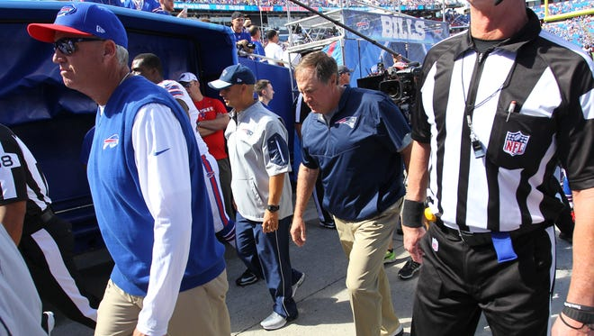 Buffalo Bills head coach Rex Ryan and New England Patriots head coach Bill Belichick leave the field after the Sept. 20 game at Ralph Wilson Stadium.