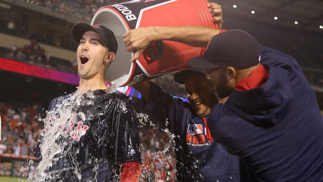 Pitcher Rick Porcello of Chester is doused after Boston defeated the Angels on Friday night. (AP Photo/Reed Saxon)