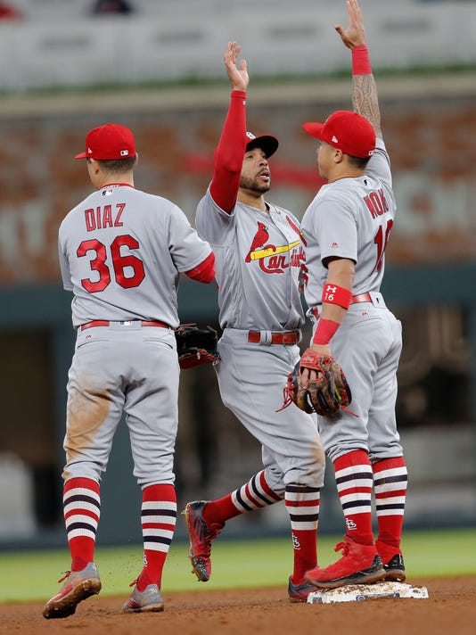 St. Louis Cardinals center fielder Tommy Pham (28) and second baseman Kolten Wong (16) celebrate after a baseball game against the Atlanta Braves, Friday, May 5, 2017, in Atlanta. (AP Photo/John Bazemore)