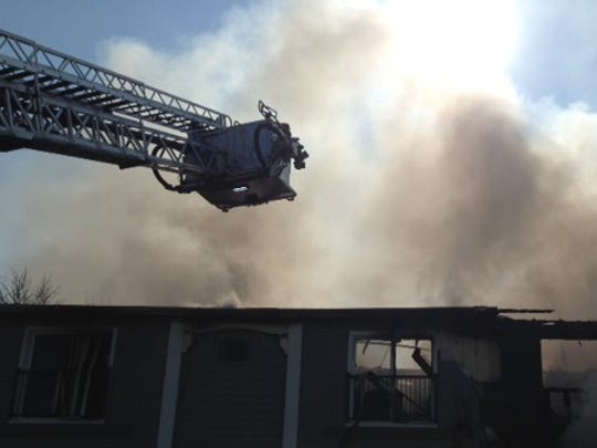 Firefighters extend aerial ladder over the Pines at