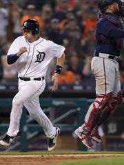 Tigers catcher Grayson Greiner beats the throw to Twins catcher Bobby Wilson to score during the eighth inning of the Tigers' 5-2 win over the Twins on Wednesday, June 13, 2018, at Comerica Park.