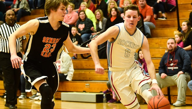 Ridgedale's Mo Britton looks to get past Seneca East's Drew Tipple during the Ridgedale against Seneca East basketball game on Friday. Britton is one of six area basketball players to make first team All-Central District.