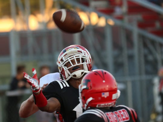 Hughes  Dominck McConnal Jr intercepts a pass during the Big Red's game against Deer Park, Wednesday, Aug. 23.