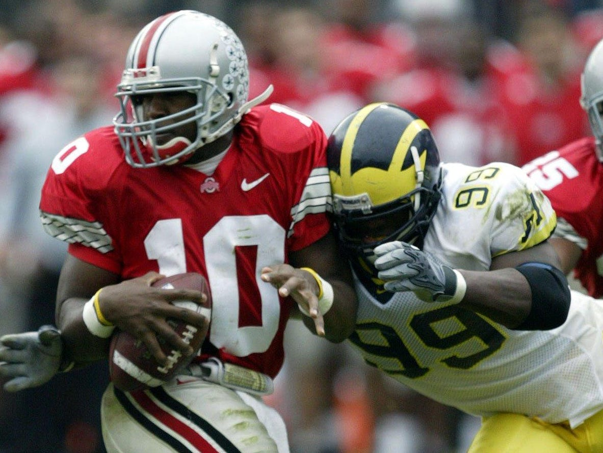 Woods' head makes contact with Ohio State quarterback Troy Smith in 2004.