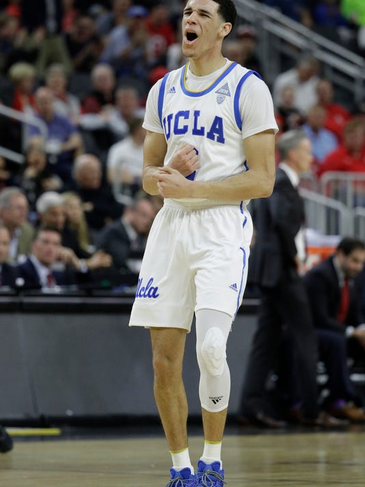 UCLA's Lonzo Ball reacts after scoring against Southern California during the first half of an NCAA college basketball game in the quarterfinals of the Pac-12 men's tournament Thursday, March 9, 2017, in Las Vegas. (AP Photo/John Locher)