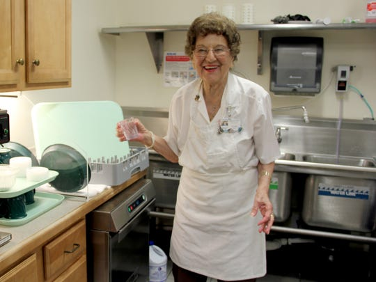 "Dorothy Scotto works in the St. Lucie Hospice House kitchen, washing and sterilizing pots and pans, putting away groceries, and cleaning and preparing vegetables. ""I take better care of that kitchen than I ever did of my own,"" Scotto said with a laugh."