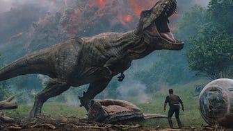 "Owen (Chris Pratt) meets a T. rex in ""Jurassic World: Fallen Kingdom."""