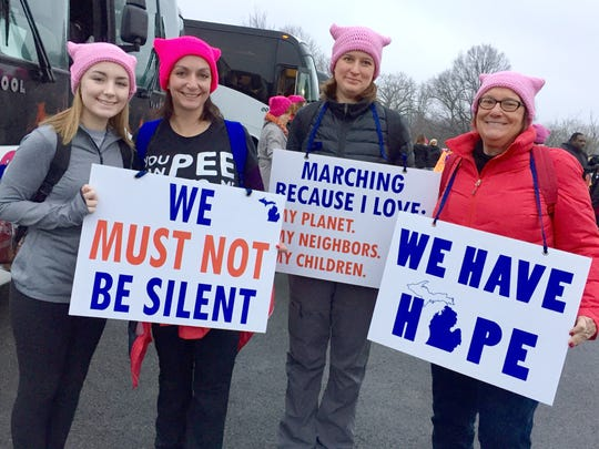 Alyssa Christensen, 16, of Holly (left), her mom, Maureen Christensen, 40, of Holly, Alissa Malerman, 40, of Berkley and Diane Lampe, 63, of Rockwood marched Saturday in Washington.